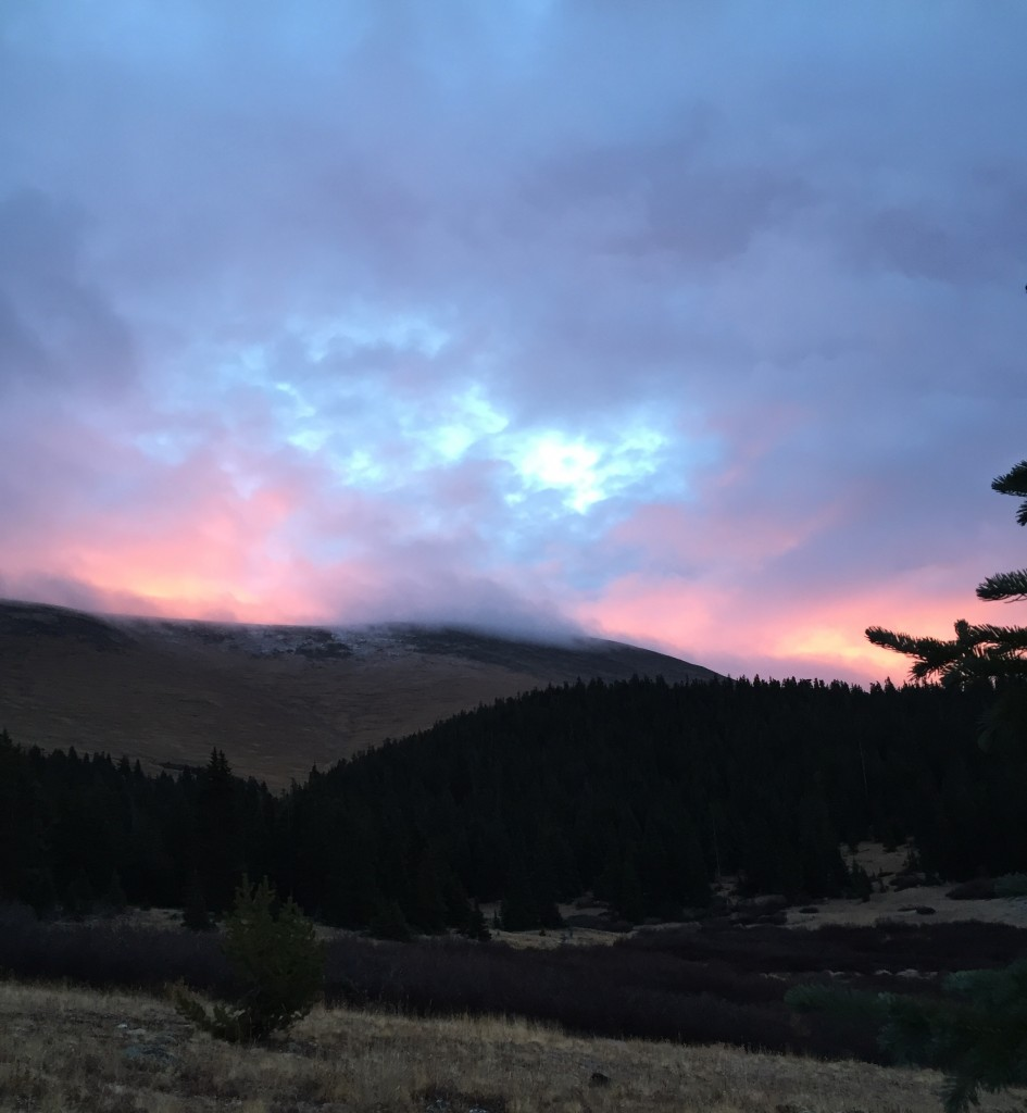 Dawn breaks over the snow-tipped clearing above tree line on Weston Pass.
