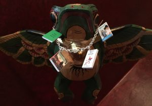 Stephanie gifted me with a charm bracelet, the charms are my book covers with one titled: My Next Book! I hung it on my flying frog (Orville from Waterwight) above my red room work space!
