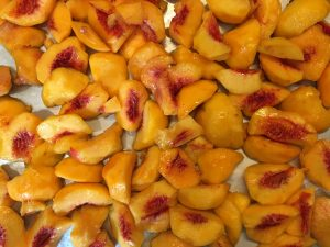 Peaches, peaches, more peaches for the freezer!